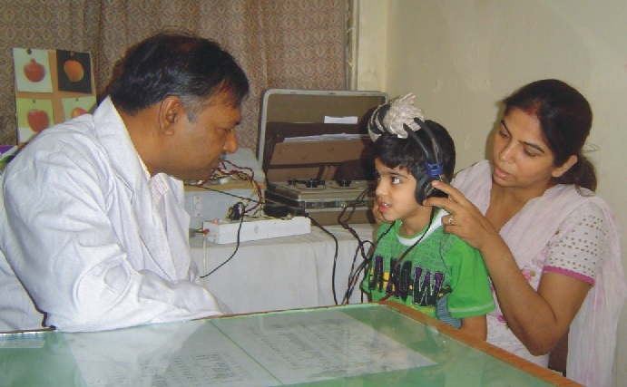 A child is being treated by Speech Therapist